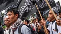 Indonesia bans Hizbut Tahrir group that seeks global caliphate
