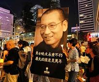 Liu Xiaobo dies at 61: Thousands march in Hong Kong in memory of pro-democracy campaigner