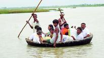 Kurnool district devotees brave odds to cross Krishna