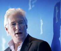 Gere faults Trump for blurring meaning of 'refugee' and 'terrorist'