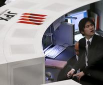 Nikkei hits more than one-month high on weak yen, sales tax hike delay
