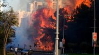 Tens of thousands flee Isreal fires