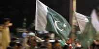 Pakistan's former Ambassador Husain Haqqani waits for his passport