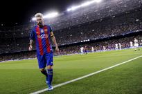 Messi double brings Barca relief