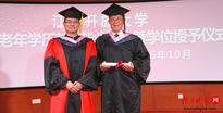 A picture of pride and humility as 88-year-old Zhang (right) poses for a graduation photo.