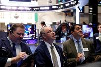 Wall Street higher as Apple powers tech rally; Fed in focus