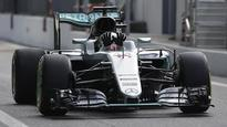 Hamilton expects close fight between Ferrari and Red Bull