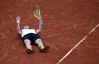 Gasquet carrying French flag at Roland Garros