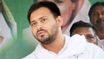 Video: Ex deputy CM Tejaswi Yadav weighted with coins in a public meet; mob looted all the coins