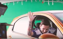 Messi shows his new red car to the world