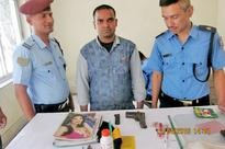 Computer engineer held with pistol being smuggled from India to Nepal