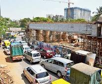 Traffic cops talk tough on flyover work