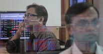 Sensex gains on auto makers, but caution seen ahead of inflation data