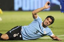 Suarez escapes punishment after qualifier punch