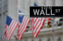 Wall Street edges up on heavy earnings day; Fed on tap