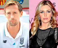 Burglars leave ex England striker Peter Crouch's wife Abbey Clancy 'shaken'
