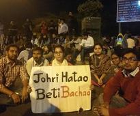 #ArrestJohri: JNU students take to streets demanding professor's dismissal