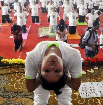 From mountains to seas, India celebrates Yoga Day