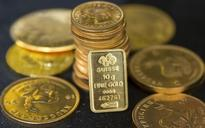 Gold eases as dollar jumps to fresh near nine-month high