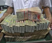 Rupee falls to two-year low, recovers