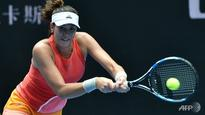 Tennis: Muguruza labours into Open third round