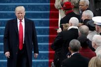 Trump era begins with Obamacare rollback, protests