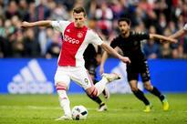 Ajax draws 2-2 with Utrecht, stays atop Erediv... Arkadiusz Milik (L) of Ajax Amsterdam scores a goal during the Dutch Eredivi...