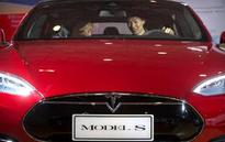The Latest: Truck firm in Tesla crash had safety violations