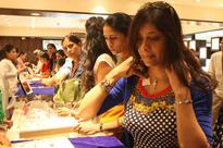 Gold gains Rs 100 on jewellers buying, higher global cues