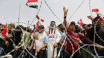 Iraqi Troops Use Tear Gas Against Green-Zone Protesters