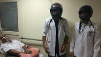 Delhi: AIIMS docs wear helmets in support of striking Maharashtra residents doctors