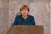 Merkel to discuss Turkish parliament immunity vote with Erdogan