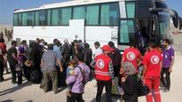 Syria: First evacuees leave besieged Damascus suburb Daraya