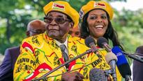 Breakfast with Mugabe: a play, a friend and a tragedy in two acts