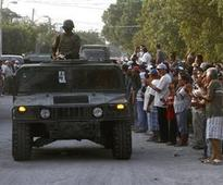 Besieged Mexican town cheers arrival of soldiers