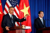 Vietnam caught between new, old friends