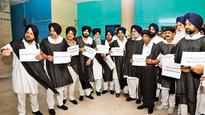 Punjab Oppn members don black robes to stage protest