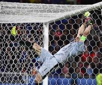 Fail: Italy keeper Gianluigi Buffon fell badly whilst trying to swing on the crossbar (Video)