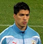 Liverpool's Suarez banned 10 games for biting, asks forgiveness