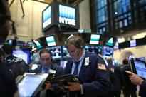 Wall St. falls as investors ready for Trump's inauguration