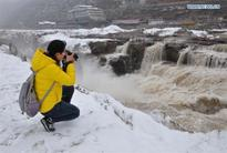 Snow scenery of Hukou Waterfall, N China