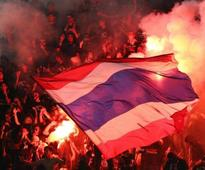Police hunt football fans firing flares at Suzuki Cup final