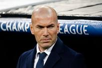 Zinedine Zidane flashes the world after his trousers rip on the Real Madrid touchline