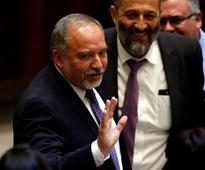Hardliner Lieberman sworn in as Israel defence...
