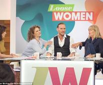 Linda Robson can't wipe the smile off her face as Matt Goss greets her with a snog