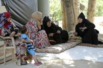 Lebanon struggles between two different waves of refugees