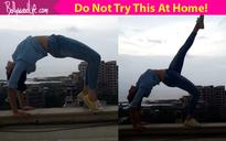 OH FREAK! Adah Sharma tries some daredevil yoga stunts on a terrace  watch video