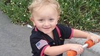 Australian toddler burned in house fire fights for his life