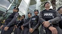 Thai police charge 2 eight-year-old girls who tore down pink lists
