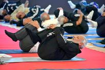 PM, Rajnath take part in yoga session with top cops